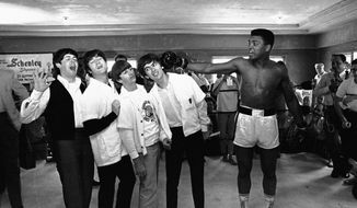 ADVANCE FOR USE SUNDAY, FEB. 23, 2014 AND THEREAFTER - FILE - In this Feb. 18, 1964 file photo, Cassius Clay poses with The Beatles, from left, Paul McCartney, John Lennon, Ringo Starr and George Harrison, while visiting the heavyweight boxing contender at his training camp in Miami Beach, Fla. Fifty years ago, these future legends met through a chance of publicity matchmaking. (AP Photo)