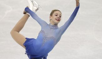 Gracie Gold of the United States competes in the women's free skate figure skating finals at the Iceberg Skating Palace during the 2014 Winter Olympics, Thursday, Feb. 20, 2014, in Sochi, Russia. (AP Photo/Darron Cummings)