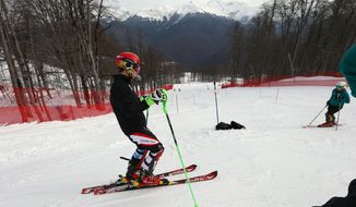 Austria's Marcel Hirscher trains for the men's slalom at the Alpine ski venue at the Sochi 2014 Winter Olympics, Thursday, Feb. 20, 2014, in Krasnaya Polyana, Russia. (AP Photo/Alessandro Trovati)
