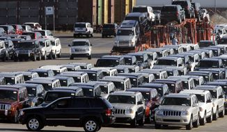 ** FILE ** In this Nov. 1, 2007, file photo Jeep Grand Cherokees and Commanders are staged for transportation on truck and train at the Chrysler Jefferson North Assembly facility in Detroit. (AP Photo/Paul Sancya, File)