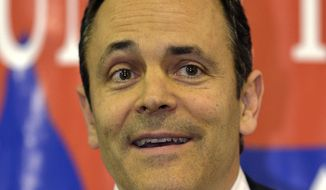 ** FILE ** Matt Bevin, Republican candidate for U.S. Senate, speaks to a gathering at the Spencer County GOP Lincoln Day Dinner on Friday, Feb. 7, 2014, in Fisherville, Ky. Bevin is running against Mitch McConnell R-Ky. (AP Photo/Timothy D. Easley)
