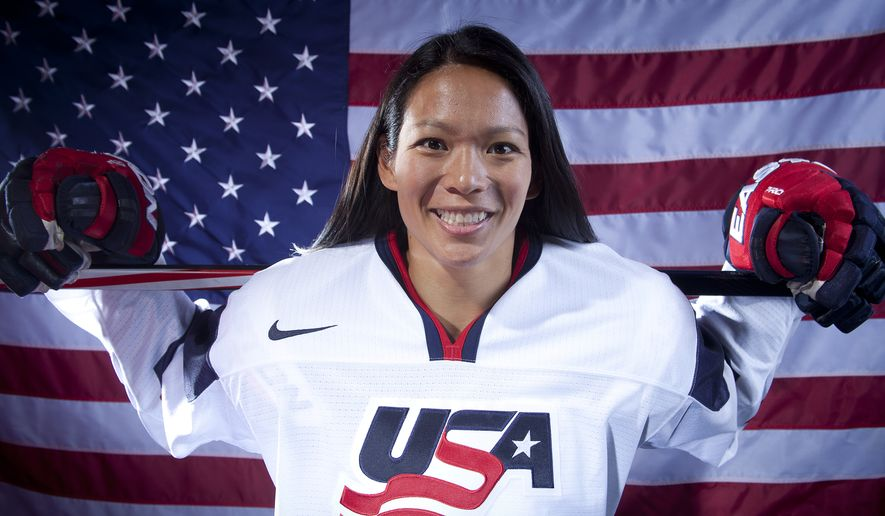 United States Olympic Winter Games Hockey player Julie Chu poses for a portrait at the 2013 Team USA Media Summit on Monday, October 2, 2013 in Park City, UT. (AP Photo/Carlo Allegri)