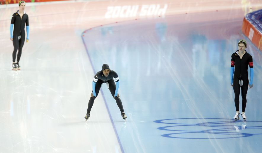 The U.S. speedskating team Shani Davis, center, Brian Hansen, right, and Jonathan Kuck, top left, catch their breath after competing in the men's speedskating team pursuit quarterfinals at the Adler Arena Skating Center during the 2014 Winter Olympics in Sochi, Russia, Friday, Feb. 21, 2014. (AP Photo/Patrick Semansky)
