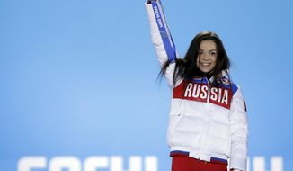 Women's free skate figure skating gold medalist Adelina Sotnikova of Russia celebrates during the medals ceremony at the 2014 Winter Olympics, Friday, Feb. 21, 2014, in Sochi, Russia. (AP Photo/David Goldman)