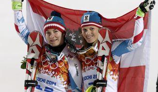Women's slalom winners from Austria Kathrin Zettel (bronze) and Marlies Schild (silver) pose for photographers at the Sochi 2014 Winter Olympics, Friday, Feb. 21, 2014, in Krasnaya Polyana, Russia. (AP Photo/Gero Breloer)
