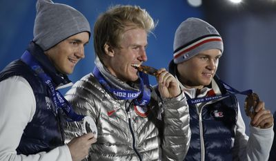 Men's giant slalom medalists, from left, France's Steve Missillier, silver, the United States' Ted Ligety, gold, and France's Alexis Pinturault, bronze, pose with their medals at the 2014 Winter Olympics in Sochi, Russia, Thursday, Feb. 20, 2014.  (AP Photo/Morry Gash)