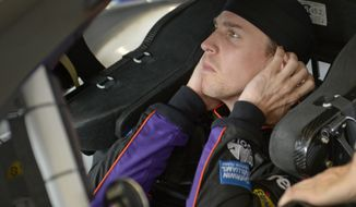 Denny Hamlin gets ready for a practice session for the Daytona 500 NASCAR Sprint Cup Series auto race at Daytona International Speedway in Daytona Beach, Fla., Friday, Feb. 21, 2014. (AP Photo/Phelan M. Ebenhack)