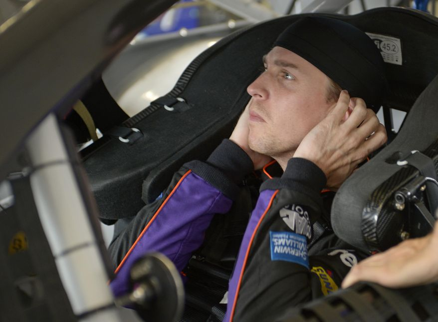 Denny Hamlin gets ready for a practice session for the Daytona 500 NASCAR Sprint Cup Series auto race at Daytona International Speedway in Daytona Beach, Fla., Friday, Feb. 21, 2014. (AP Photo/Phelan M. Ebenhack)