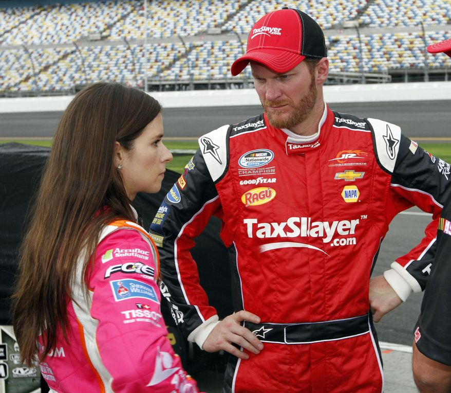 Dale Earnhardt Jr, right, talks with Danica Patrick during qualifying for Saturday's NASCAR Nationwide series auto race at Daytona International Speedway in Daytona Beach, Fla., Friday, Feb. 21, 2014. (AP Photo/David Graham)
