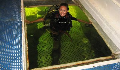 This photo provided by Roane State Community College shows, Jessica Fain, an adjunct professor of biology at Roane State Community College in Tennessee,who has spent 80 hours in the underwater habitat in Key Largo, Fla. (AP Photo/Roane State Community College)