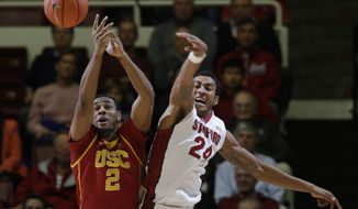Southern California forward Roschon Prince (2) battles for a rebound against Stanford forward Josh Huestis (24) during the first half of an NCAA college basketball game on Thursday, Feb. 20, 2014, in Stanford, Calif. (AP Photo/Marcio Jose Sanchez)