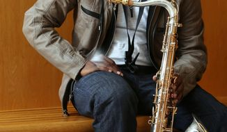 In this Feb. 6, 2014 photo, saxophone phenom Bernard Jackson poses for a photo in Tallahassee, Fla. Jackson, a 22-year-old Florida A&M senior, started playing the saxophone at the age of 11. Since then, he has performed with the likes of B.B. King and Prince. (AP Photo/Tallahassee Democrat, Mike Ewen)  NO SALES