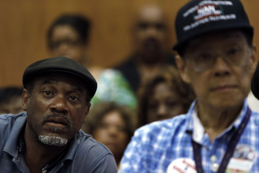 FILE - In this July 22, 2013 file photo Tony Brown, left, a Department of Transportation retiree, listens to union leaders speak in Detroit. Court documents show the city, which now hopes to emerge from bankruptcy, owes more than 100,000 creditors that include individual retirees, city workers, businesses, property owners and litigants. (AP Photo/Paul Sancya)