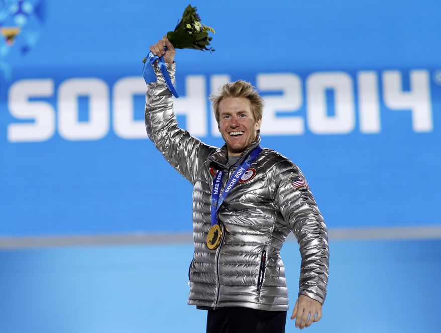 Men's giant slalom gold medalist Ted Ligety of the United States waves during the medals ceremony at the 2014 Winter Olympics, Thursday, Feb. 20, 2014, in Sochi, Russia. (AP Photo/David Goldman)