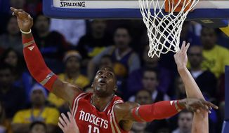 Golden State Warriors' David Lee shoots over Houston Rockets' Dwight Howard (12) during the first half of an NBA basketball game Thursday, Feb. 20, 2014, in Oakland, Calif. (AP Photo/Ben Margot)