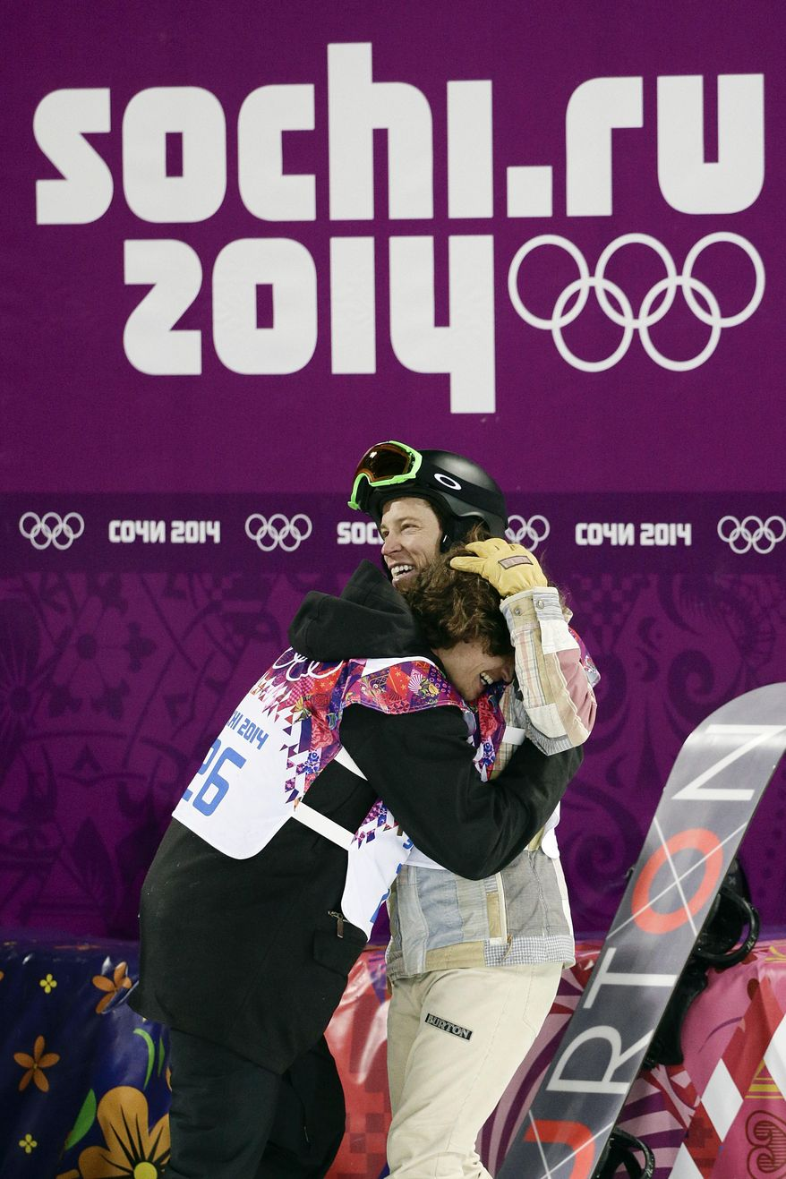 Switzerland's Iouri Podladtchikov, left, celebrates with Shaun White, of the United States, after Podladtchikov won the gold medal in the men's snowboard halfpipe final at the Rosa Khutor Extreme Park, at the 2014 Winter Olympics, Tuesday, Feb. 11, 2014, in Krasnaya Polyana, Russia. (AP Photo/Jae C. Hong, File)