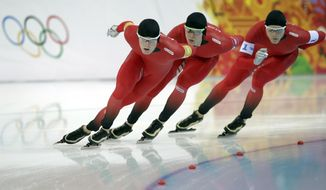 Norway's Sverre Lunde Pedersen, Havard Lorentzen and Havard Bokko, from left to right, compete in the men's speedskating team pursuit quarterfinals at the Adler Arena Skating Center during the 2014 Winter Olympics in Sochi, Russia, Friday, Feb. 21, 2014.  (AP Photo/Matt Dunham)