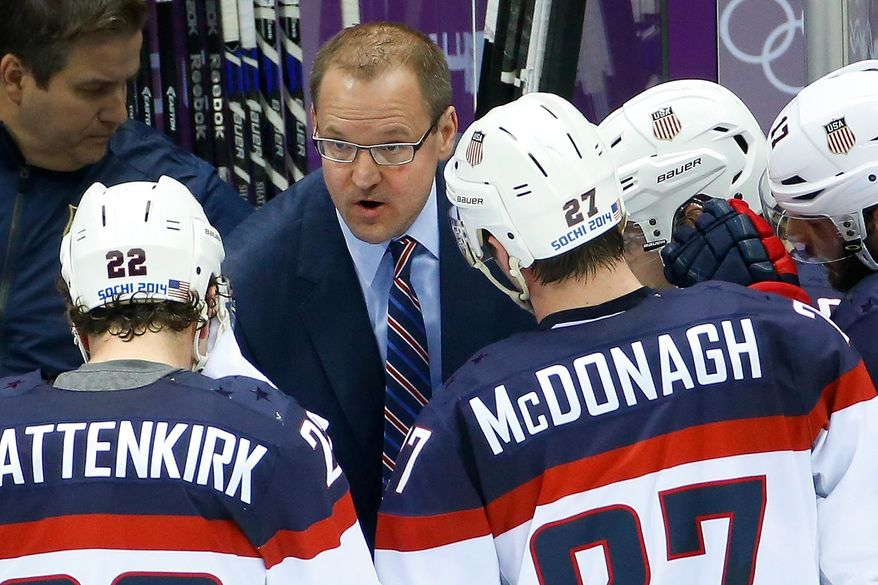 USA head coach Dan Bylsma task to the team during a break in the action in the second period of the men's semifinal ice hockey game against Canada at the 2014 Winter Olympics, Friday, Feb. 21, 2014, in Sochi, Russia. (AP Photo/Matt Slocum)