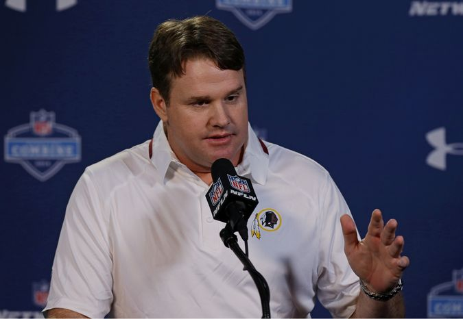 Washington Redskins head coach Jay Gruden answers a question during a news conference at the NFL football scouting combine in Indianapolis, Friday, Feb. 21, 2014. (AP Photo/Michael Conroy)