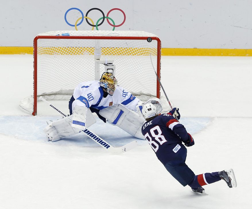 USA forward Patrick Kane hits the post as he shoots on Finland goaltender Tuukka Rask during the second period of the men's bronze medal ice hockey game at the 2014 Winter Olympics, Saturday, Feb. 22, 2014, in Sochi, Russia. (AP Photo/David J. Phillip  )