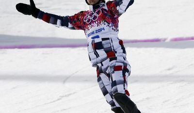 Russia's Vic Wild crosses the finish line to win the gold medal in the men's snowboard parallel slalom final at the Rosa Khutor Extreme Park, at the 2014 Winter Olympics, Saturday, Feb. 22, 2014, in Krasnaya Polyana, Russia.  (AP Photo/Andy Wong)