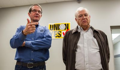 In this Feb. 14, 2014, photo, United Auto Workers President Bob King, left, and Dennis Williams, now secretary-treasurer for the union, right, discuss the union's 712-626 defeat in an election at the Volkswagen plant in Chattanooga, Tenn. The UAW on Friday, Feb. 21, 2014, filed an objection with the National Labor Relations Board seeking to vacate the result and order a new election. (AP Photo/Erik Schelzig)
