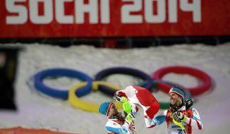 Men's slalom winners Austria's Mario Matt (gold), right, and his teammate Austria's Marcel Hirscher (silver) celebrate on the podium at the Sochi 2014 Winter Olympics, Saturday, Feb. 22, 2014, in Krasnaya Polyana, Russia  (AP Photo/Gero Breloer)