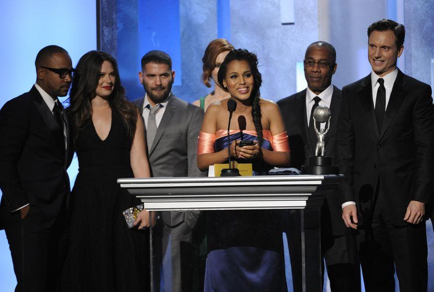 """From left, Columbus Short, Katie Lowes, Guillermo Díaz, Darby Stanchfield, Kerry Washington, Joe Morton, and Tony Goldwyn accept the award for outstanding drama series for """"Scandal"""" at the 45th NAACP Image Awards at the Pasadena Civic Auditorium on Saturday, Feb. 22, 2014, in Pasadena, Calif. (Photo by Chris Pizzello/Invision/AP)"""