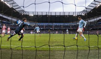 With Stoke goalkeeper Asmir Begovic, left, stranded, Manchester City's Edin Dzeko, right, misses an open goal during their English Premier League soccer match at the Etihad Stadium, Manchester, England, Saturday, Feb. 22, 2014. (AP Photo/Jon Super)