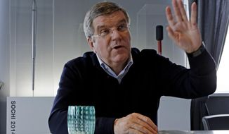 International Olympic Committee President Thomas Bach answers a question in his office during an Associated Press interview at the 2014 Winter Olympics, Saturday, Feb. 22, 2014, in Sochi, Russia. (AP Photo/Morry Gash)