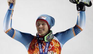 Men's slalom bronze medal winner, Norway's Henrik Kristoffersen,celebrates on the podium at the Sochi 2014 Winter Olympics, Saturday, Feb. 22, 2014, in Krasnaya Polyana, Russia.  (AP Photo/Christophe Ena)