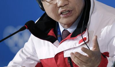 President of the Pyeongchang Organizing Committee for the 2018 Winter Olympics Kim Jin-sun talks to journalists during a press conference during the 2014 Winter Olympics, Saturday, Feb. 22, 2014, in Sochi, Russia. (AP Photo/Bernat Armangue)