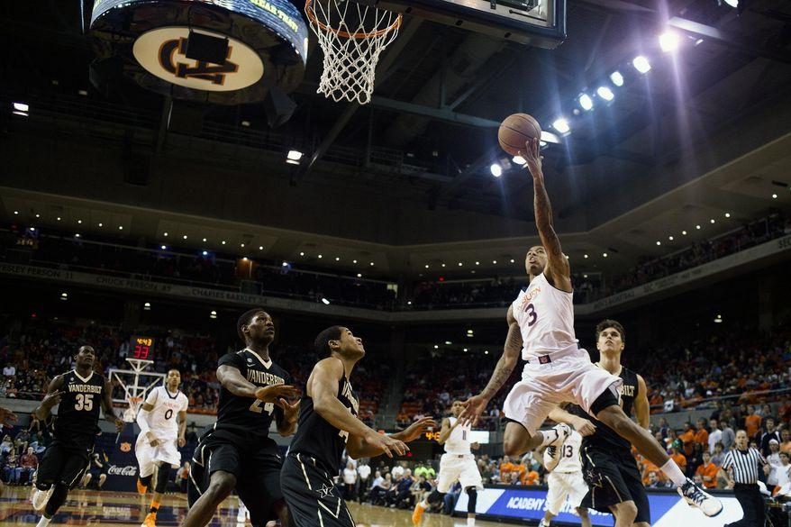 Auburn's Chris Denson (3) goes for a layup as Vanderbilt's Dai-Jon Parker (24) and Carter Josephs (14) look on during an NCAA college basketball game, Saturday, Feb. 22, 2014, in Auburn, Ala. Vanderbilt won 67-59. (AP Photo/Opelika-Auburn News, Albert Cesare)