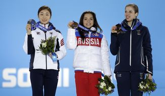 Women's free skate figure skating medalists, from left, South Korea's Yuna Kim, silver, Russia's Adelina Sotnikova, gold, and Italy's Carolina Kostner, bronze, pose with their medals at the 2014 Winter Olympics in Sochi, Russia, Friday, Feb. 21, 2014.  (AP Photo/David Goldman)