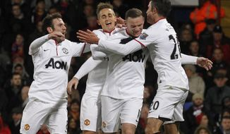 Manchester United's Wayne Rooney, second right, celebrates his goal against Crystal Palace with teammates during their English Premier League soccer match at Selhurst Park, London, Saturday, Feb. 22, 2014. (AP Photo/Sang Tan)