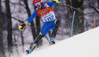 Ukraine's Dmytro Mytsak skis during the first run of the men's slalom at the Sochi 2014 Winter Olympics, Saturday, Feb. 22, 2014, in Krasnaya Polyana, Russia.(AP Photo/Alessandro Trovati)