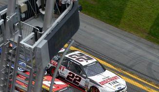 Regan Smith (7) beats Brad Keselowski (22) at the finish line to win the NASCAR Nationwide Series auto race at Daytona International Speedway in Daytona Beach, Fla., Saturday, Feb. 22, 2014. (AP Photo/Phelan M. Ebenhack)
