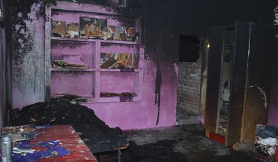 In this Thursday, Feb. 20, 2014, the burnt  house of  Bunty Sharma, 32, an auto rickshaw driver, is seen, in Agra, India. Bunty fatally stabbed his American wife Erin W. Willinger before killing himself in Agra, the city that is home to the Taj Mahal and where the couple married in October, police said Saturday. Willinger's body was found with multiple stab wounds late Thursday night in a deserted part of the city, said Agra police chief Shalabh Mathur. Her husband Bunty Sharma committed suicide by igniting cooking gas and causing a massive explosion in his home, Mathur said. (AP Photo)
