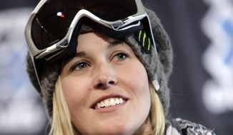 FILE - In this Jan. 21, 2009 file photo, superpipe skier, Sarah Burke of  Canada looks on during a news conference at the Winter X Games, in Aspen, Colo. Burke, who pushed hard to get halfpipe and slopestyle skiing into the Olympics, died in a training accident in 2012, less than a year after the sports were added. Before the 2014 Winter Olympics started, the Canadian freestyle team spread Burke's ashes in the halfpipe and around other areas in the mountains above Sochi. Another tribute they paid to the fallen freeskiing star: All those medals they're bringing home. Canada led the world with nine medals at the freestyle events, including four gold.  (AP Photo/Nathan Bilow, File)