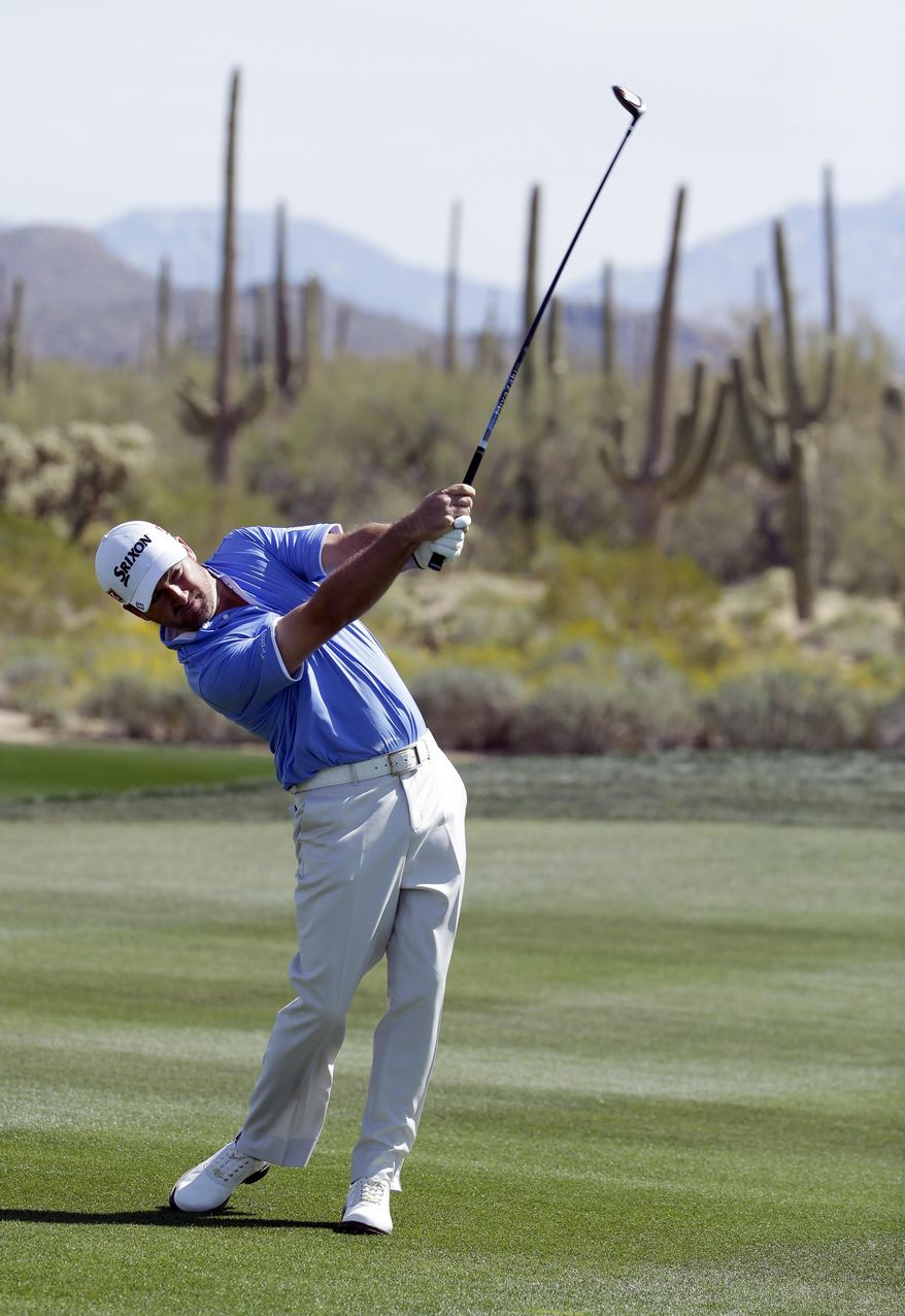 Graeme McDowell, of Northern Ireland, hits from the fairway on the second hole in his match against Victor Dubuisson, of France, during the fourth round of the Match Play Championship golf tournament on Saturday, Feb. 22, 2014, in Marana, Ariz. (AP Photo/Ted S. Warren)