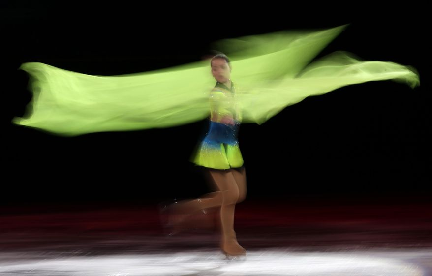Adelina Sotnikova of Russia performs during the figure skating exhibition gala at the Iceberg Skating Palace during the 2014 Winter Olympics, Saturday, Feb. 22, 2014, in Sochi, Russia. (AP Photo/Bernat Armangue)