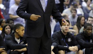 Georgetown head coach John Thompson III reacts during the first half of an NCAA college basketball game against Xavier, Saturday, Feb. 22, 2014, in Washington. Georgetown won 74-52. (AP Photo/Nick Wass)