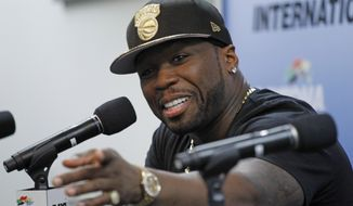 Rapper 50 Cent answers a question during a new conference before practice for Sunday's NASCAR Daytona 500 Sprint Cup series auto race at Daytona International Speedway in Daytona Beach, Fla., Saturday, Feb. 22, 2014. (AP Photo/Terry Renna)