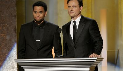 Michael Ealy, left, and Tony Goldwyn speak on stage at the 45th NAACP Image Awards at the Pasadena Civic Auditorium on Saturday, Feb. 22, 2014, in Pasadena, Calif. (Photo by Chris Pizzello/Invision/AP)