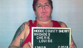 This Thursday, Feb. 20, 2014 photo released by Alturas Police Department shows Cherie Lash Rhoades. Rhoades, suspected of killing four people at the headquarters of an Indian tribe that was evicting her and her son from its land, had been under federal investigation over at least $50,000 in missing funds, a person familiar with the tribe's situation told The Associated Press on Friday. (AP Photo/Alturas Police Department)