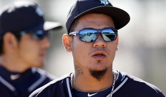 Seattle Mariners' Felix Hernandez walks out of the bullpen after a throwing session during spring training baseball practice, Thursday Feb. 20, 2014, in Peoria, Ariz. (AP Photo/Tony Gutierrez)