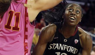 Stanford forward Chiney Ogwumike, right, eyes the basket against Southern California forward Cassie Harberts (11) during the second half of an NCAA college basketball game Friday, Feb. 21, 2014, in Los Angeles. Stanford won 64-59. (AP Photo/Alex Gallardo)