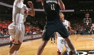 Notre Dame center Garrick Sherman (11) grabs a rebound next to Virginia guard London Perrantes during an NCAA college basketball game Saturday, Feb. 22, 2014, in Charlottesville, Va. Virginia won 70-49. (AP Photo/Andrew Shurtleff)