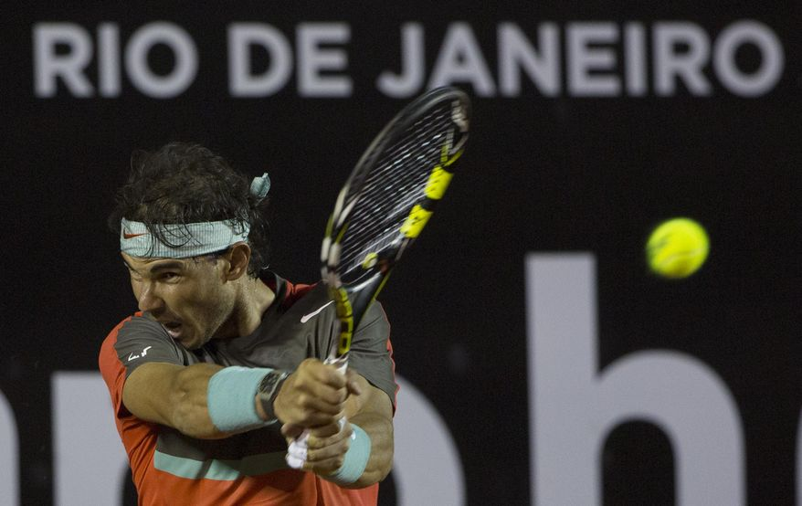 Rafael Nadal, of Spain, returns the ball to Pablo Andujar, of Spain, during a semifinal match at the Rio Open tennis tournament in Rio de Janeiro, Brazil, Saturday, Feb. 22, 2014. (AP Photo/Leo Correa)