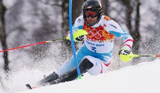 Austria's Mario Matt skis during the first run of the men's slalom at the Sochi 2014 Winter Olympics, Saturday, Feb. 22, 2014, in Krasnaya Polyana, Russia. (AP Photo/Alessandro Trovati)